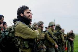 ISRAEL'S BALANCING ACT: AVOIDING ESCALATION, STOPPING ENEMY FORCE BUILD-UP