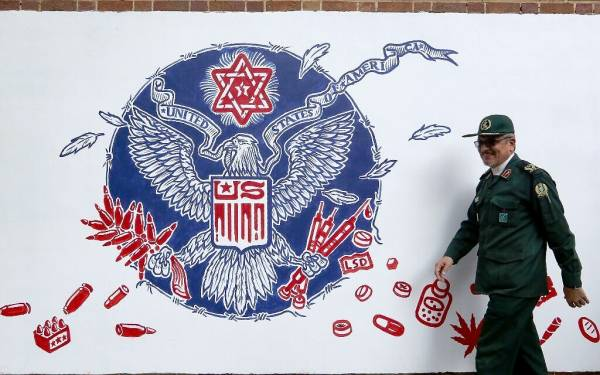 IRAN UNVEILS NEW ANTI-US MURALS AT FORMER EMBASSY